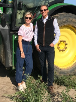 Carrot farmer Rodger Hobson with Countryfile presenter Helen Skelton
