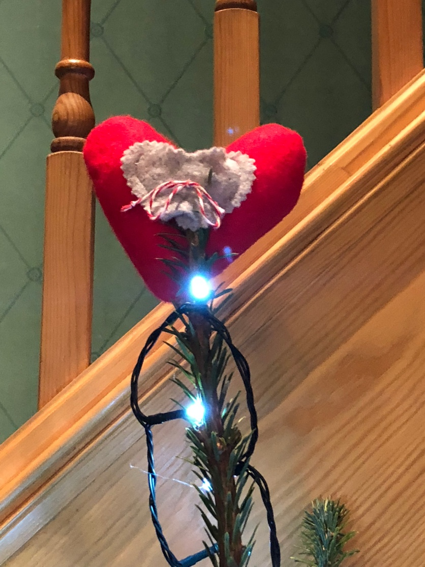 We remember Tricia at Christmas by putting er heart decoration at he top of the tree