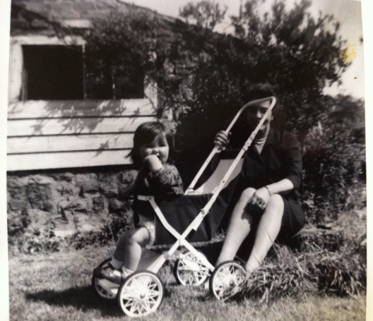 Me and my Nana Walker outside the old shed in our garden which I believe would have been used to house a pig