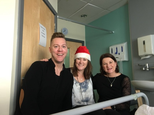 A picture taken on Christmas Day last year by my sister Tricia of me (in the hat), my friend Ian and my eldest sister Janet inSt James Hospital