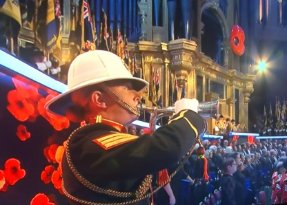 A trumpeter plays the last post